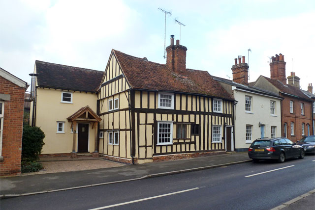 timber framed house and street view