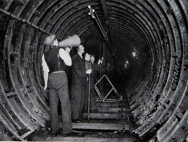 men laying rails in the tube
